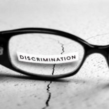 """the word """"discrimination"""" behind a pair of glasses"""