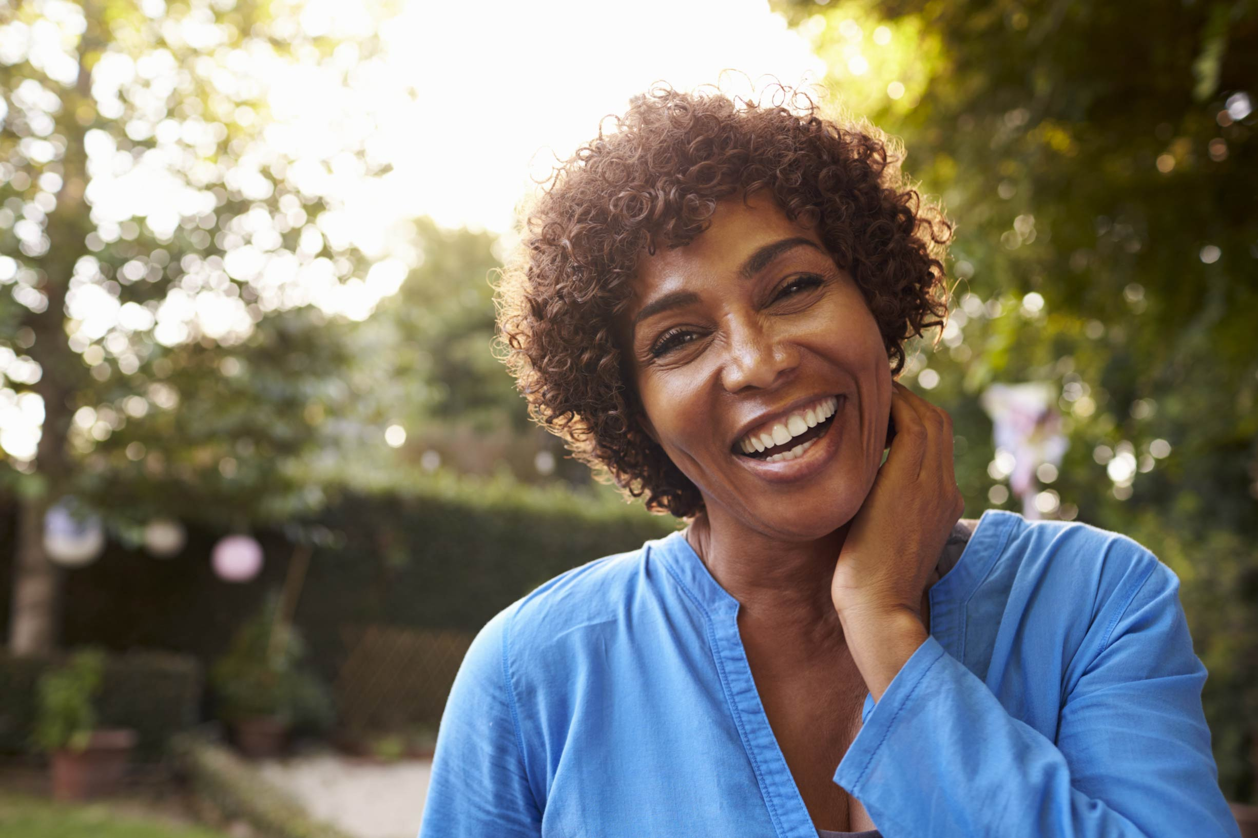 middle aged woman smiling outdoors