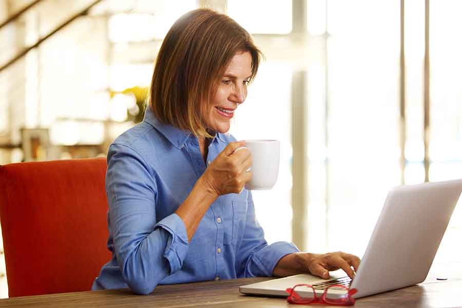 Mature lady working at home on a laptop