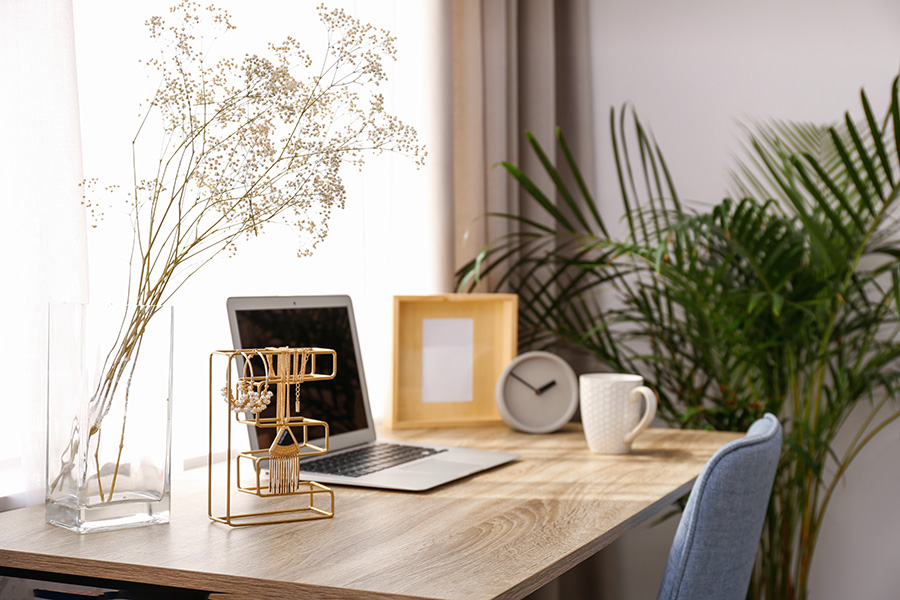 Desk with plant next to it and nice items on it