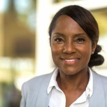 Woman in business suit smiles to camera