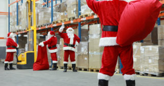 Father Christmas doing a christmas job in a warehouse